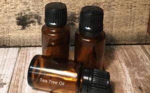 3 brown bottles of tea tree oil